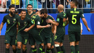 Australia celebrate Mile Jedinak's penalty goal equaliser.