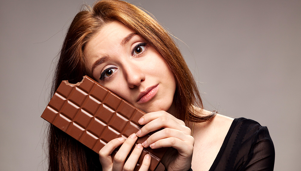 Portrait of the young girl with big chocolate