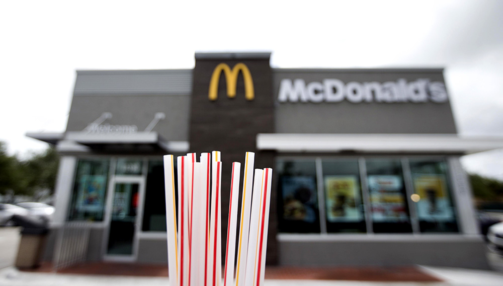 In this May 24, 2018, file photo, plastic straws from a McDonald's restaurant are shown in Doral, Fla. McDonald's said Friday, June 15, 2018 it will switch to paper straws at all its locations in the United Kingdom and Ireland, and test an alternative to plastic ones in some of its U.S. restaurants later this year. (AP Photo/Wilfredo Lee, File)