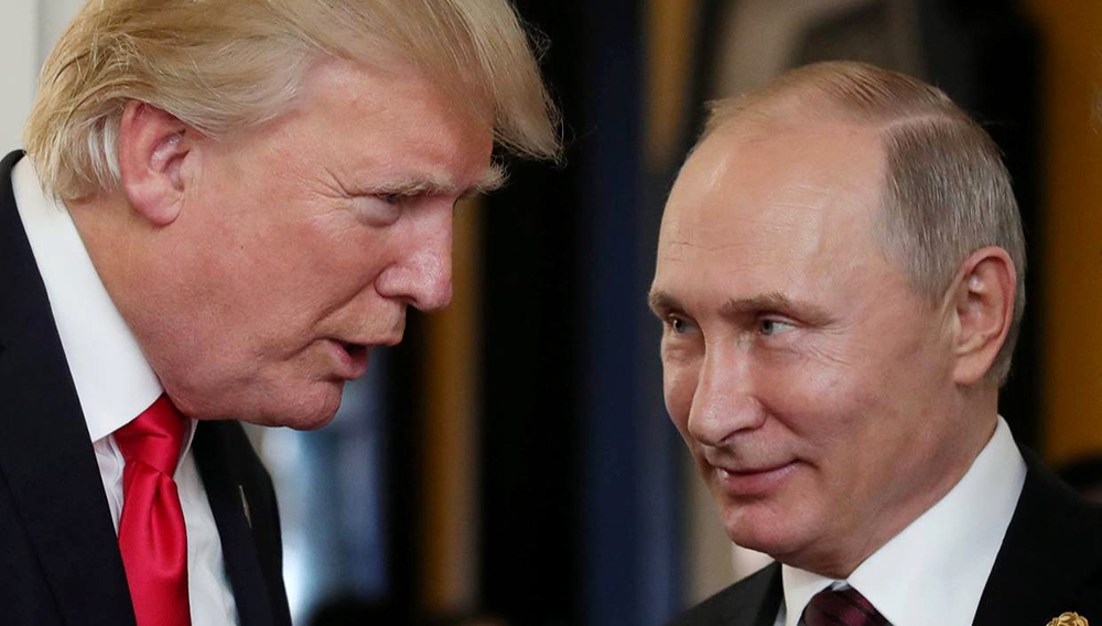 President Donald Trump, left, chatting with Russian President Vladimir Putin during a conference in Danang, Vietnnam on Nov. 11, 2017. Images PHOTO: MIKHAIL KLIMENTYEV/AGENCE FRANCE-PRESSE/GETTY IMAGES