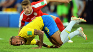 Brazil's Neymar (front) reacts during the FIFA World Cup 2018 group E preliminary round soccer match between Serbia and Brazil in Moscow, Russia.