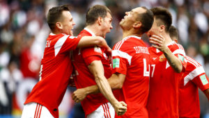 Artem Dzyuba of Russia celebrates after he scores his team's third goal during the 2018 FIFA World Cup match against Saudi Arabia on June 14.