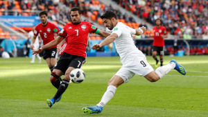 Uruguay's Luis Suarez in action with Egypt's Ahmed Fathy.
