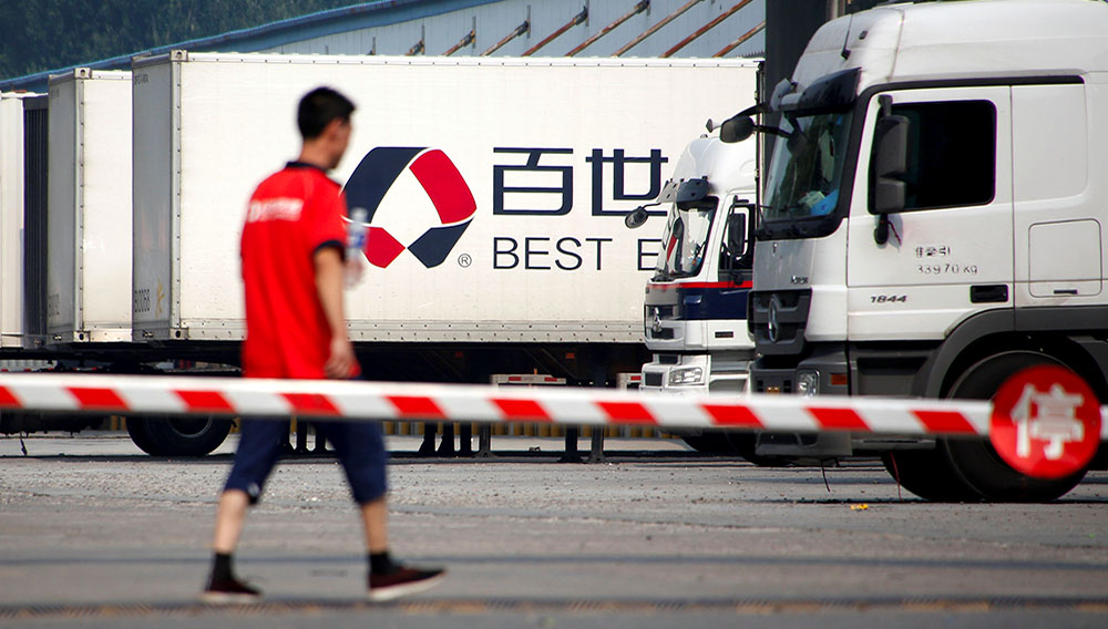 A man walks in the compound of a distribution hub of the Chinese logistics company Best Inc in Beijing, China June 27, 2017. REUTERS/Thomas Peter