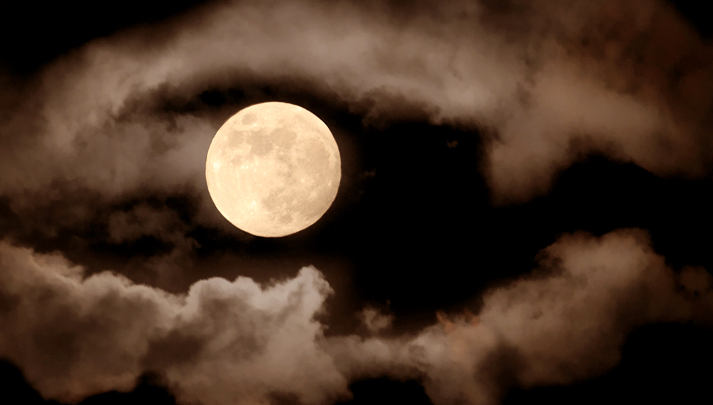 Full moon over dark sky with. Photo: Shutterstock