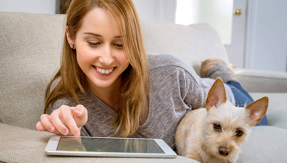 Woman with tablet and dog