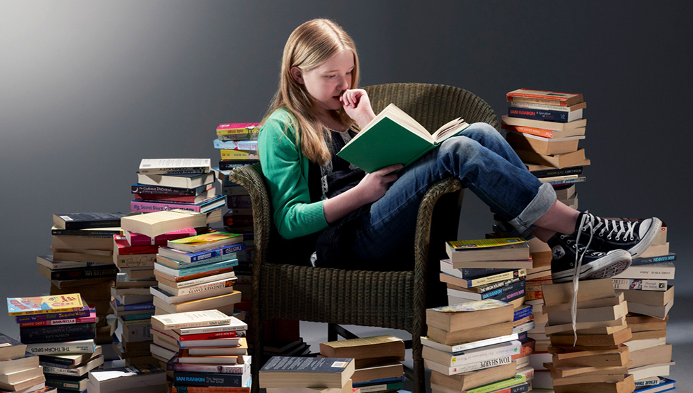 Girl reading. PHIL ASHLEY VIA GETTY IMAGES