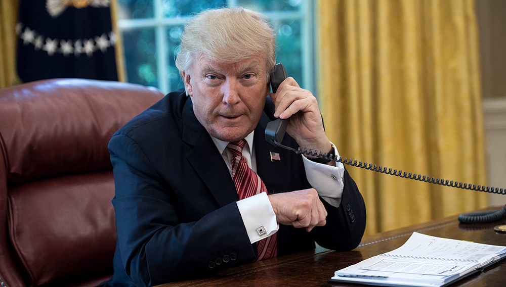 US President Donald Trump waits to speak on the phone with Irish Prime Minister Leo Varadkar to congratulate him on his recent election victory in the Oval Office at the White House in Washington, DC, on June 27, 2017. / AFP PHOTO / NICHOLAS KAMM (Photo credit should read NICHOLAS KAMM/AFP/Getty Images)