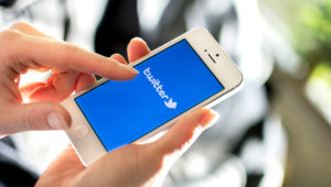People using Twitter. Photo: Shutterstock