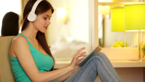 Teenager with tablet listening music