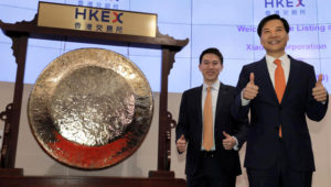 Xiaomi's Founder, Chairman and CEO Lei Jun, right, and Chew Shou Zi, senior vice president and chief financial officer gesture during the listing ceremony at the Hong Kong Stock Exchange in Hong Kong Monday, July 9, 2018. (AP Photo/Vincent Yu)