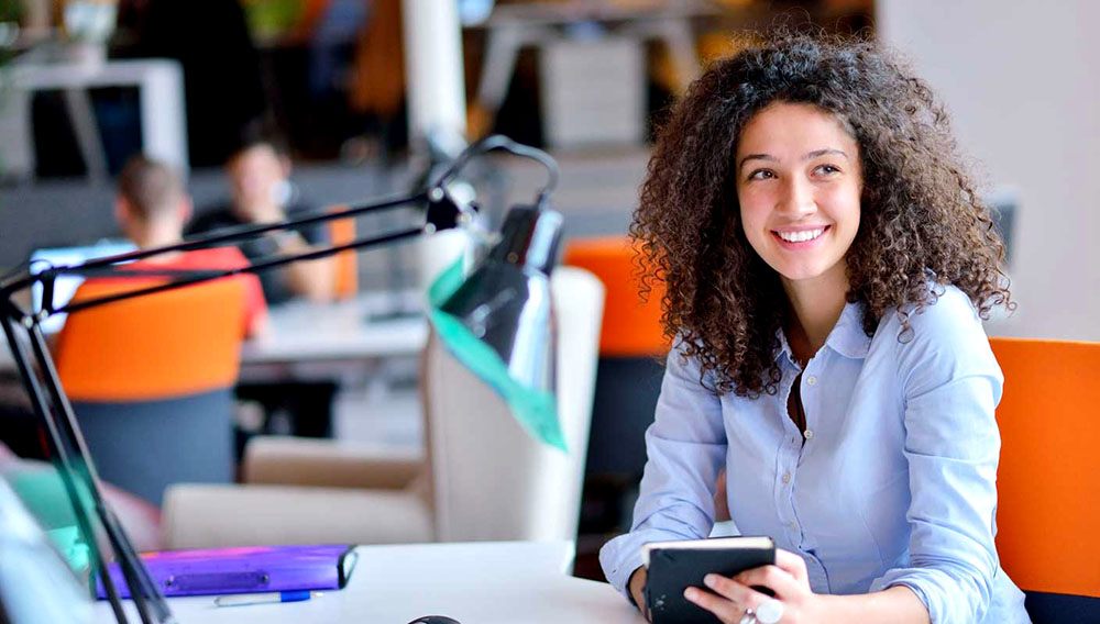 Successful business woman working at the office. Photo: Shutterstock