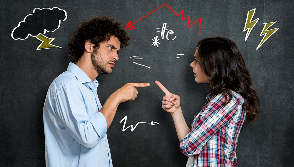 Discussion Between Guy And Girl Over Gray Background. Stock Photo/123RF.com