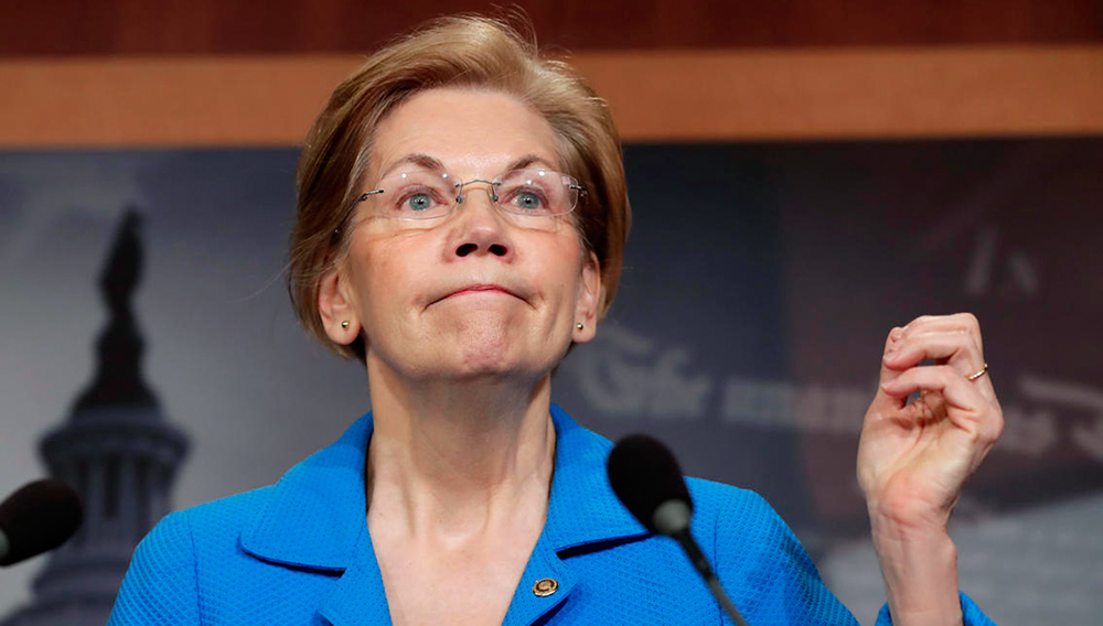 Sen. Elizabeth Warren, D-Mass., a key member of the Banking Committee, expresses her opposition to a move in the Senate to pass legislation that would roll back some of the safeguards Congress put into place after a financial crisis rocked the nation's economy ten years ago, during a news conference at the Capitol in Washington, Tuesday, March 6, 2018. Warren, who ran for office in the aftermath of the great recession in 2008, serves as ranking member of the Subcommittee on Financial Institutions and Consumer Protection. (AP Photo/J. Scott Applewhite)