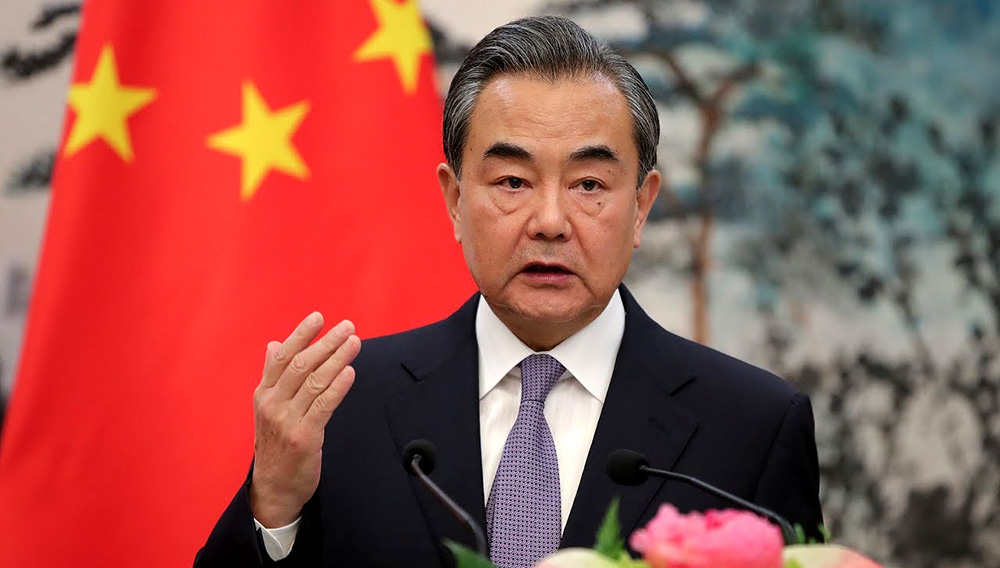 BEIJING, CHINA - SEPTEMBER 13: China's Foreign Minister Wang Yi speaks during a joint press conference with French Foreign Affairs minister Jean-Yves Le Drian at Diaoyutai State Guesthouse on September 13, 2018 in Beijing, China. (Photo by Lintao Zhang/Getty Images)