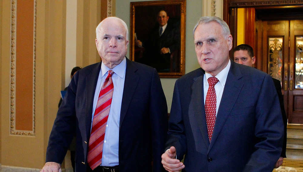 Senators John McCain (L) and Jon Kyl leave the Senate chamber to caucus in the US Capitol on December 30, 2012 in Washington, DC. SOURCE: MOLLY RILEY/AFP/Getty Images