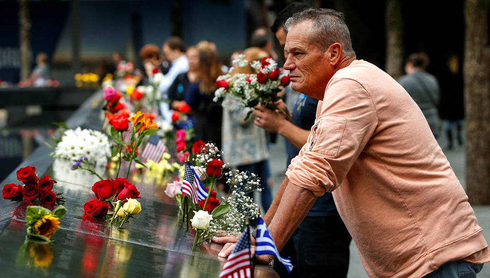 Guests visits the National 9/11 Memorial during ceremonies marking the 17th anniversary of the September 11, 2001 attacks on the World Trade Center, at the National 9/11 Memorial and Museum in New York, Sept. 11, 2018. (Photo: Brendan McDermid/Reuters)