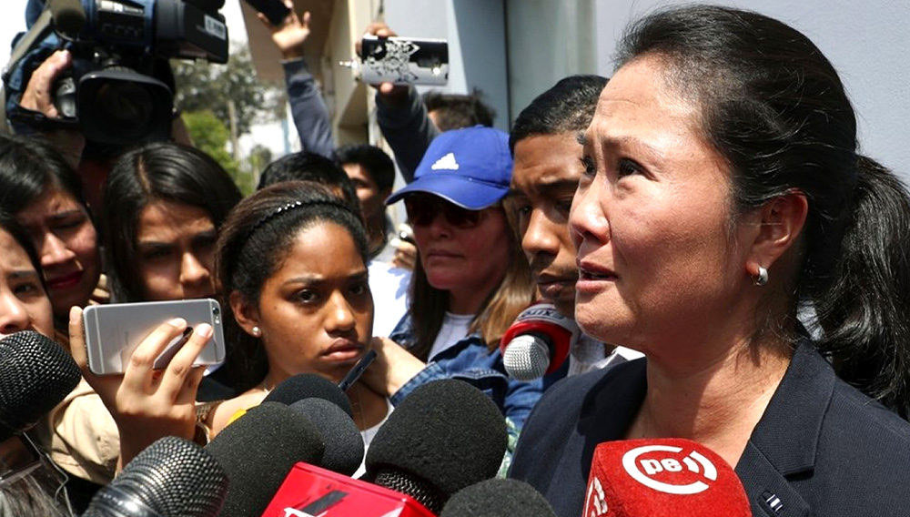 "Alberto Fujimori's daughter, Keiko Fujimori, cries as she tells reporters today is ""one of the saddest days of my life."" Photo: AP"