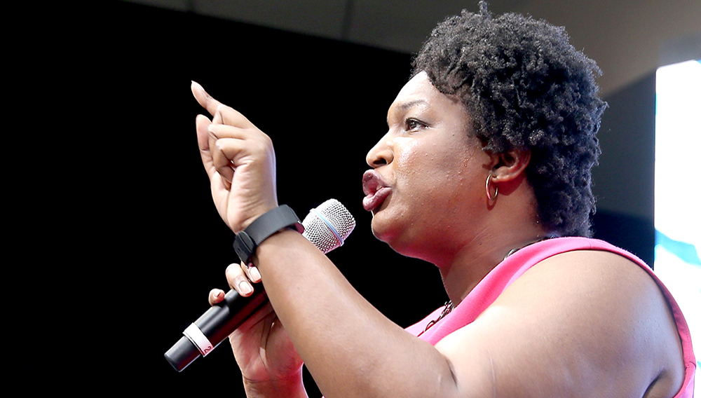 PHILADELPHIA, PA - JULY 27: House Minority Leader for the Georgia General Assembly, Stacey Abrams speaks onstage at EMILY's List Breaking Through 2016 at the Democratic National Convention at Kimmel Center for the Performing Arts on July 27, 2016 in Philadelphia, Pennsylvania. (Photo by Paul Zimmerman/Getty Images For EMILY's List)