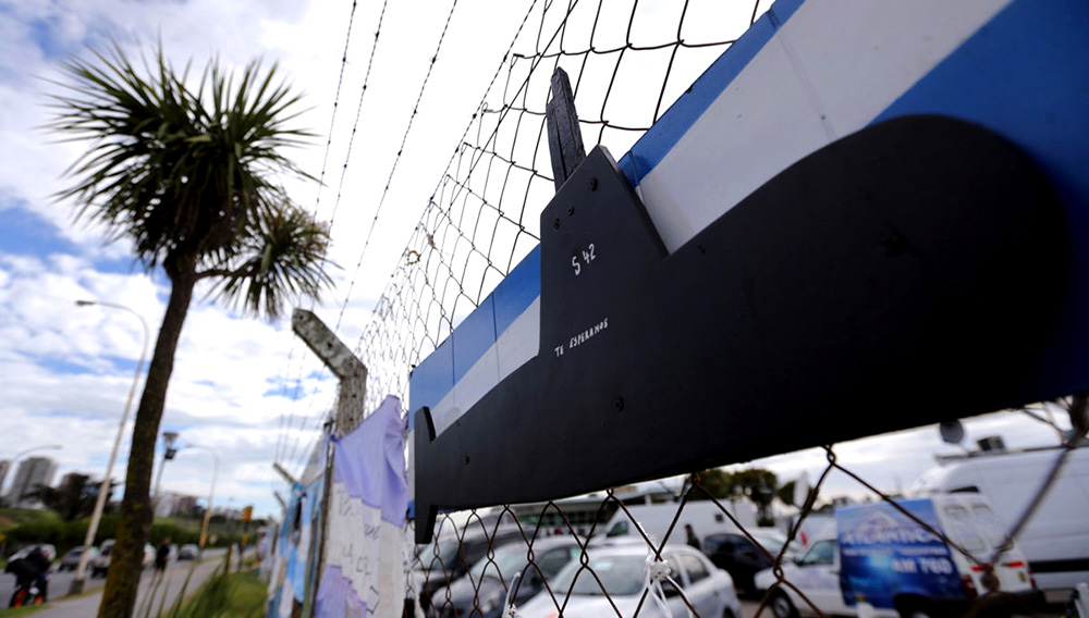 """Signs with messages in support of the 44 crew members of the missing at sea ARA San Juan submarine are seen placed on a fence at an Argentine naval base in Mar del Plata, Argentina November 22, 2017. The words on the flag read: """"We are with you"""". Picture taken November 22, 2017. REUTERS/Marcos Brindicci"""