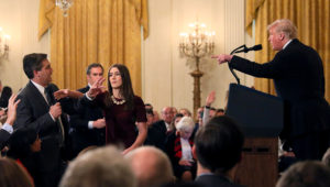 Jim Acosta initially refused to hand over the microphone to a White House member of staff, as he attempted to ask Donald Trump a follow-up question © Reuters