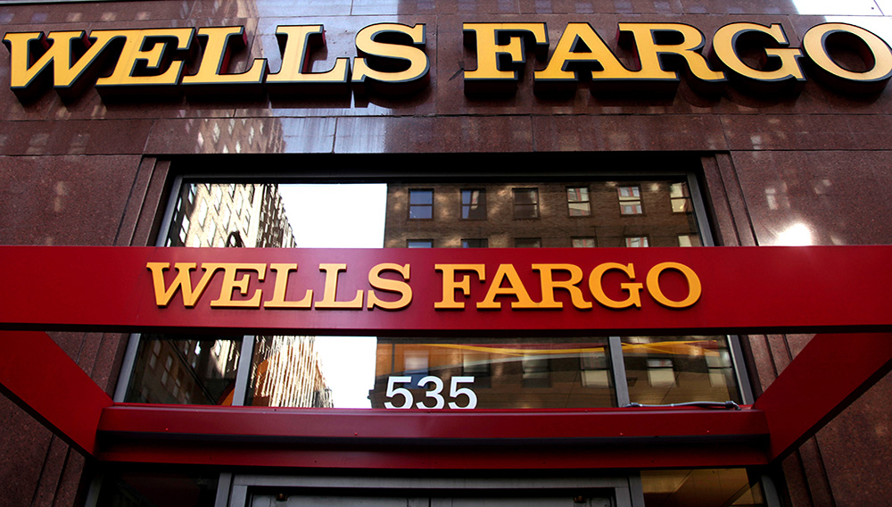 In this May 6, 2012, file photo, a Wells Fargo sign is displayed at a branch in New York. Wells Fargo has confirmed that the Securities and Exchange Commission has launched an investigation into its sales practices. Wells Fargo came under fire after it became known that the bank's employees, pushed to the limit by impossible sales goals, opened as many as 2 million bank and credit card accounts without customers' authorization. (AP Photo/CX Matiash, File)