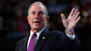In this Wednesday, July 27, 2016, file photo, former New York City Mayor Michael Bloomberg waves after speaking to delegates during the third day session of the Democratic National Convention in Philadelphia.