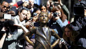 "March 8, 2017. People stop to photograph the ""Fearless Girl"" statue in New York. AP"