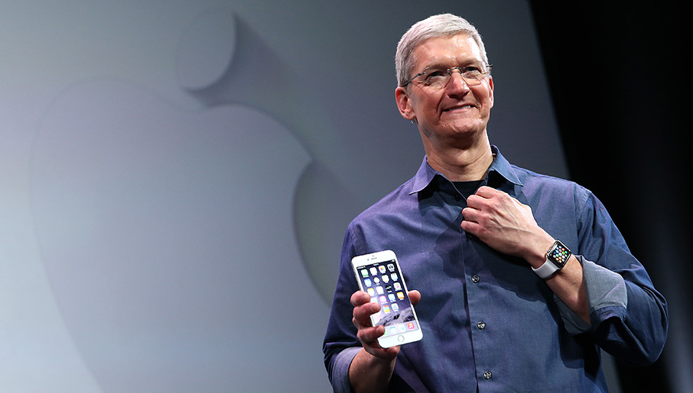 Apple CEO Tim Cook shows off the new iPhone 6 and the Apple Watch during an Apple special event at the Flint Center for the Performing Arts on September 9, 2014 in Cupertino, California. Apple is expected to unveil the new iPhone 6 and wearble tech. Photograph by Justin Sullivan—Getty
