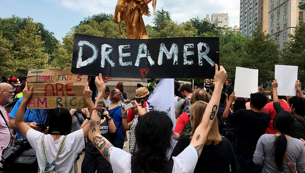 Demonstrators rally against the president's decision to discontinue DACA during protest that began at Fifth Avenue and 59th Street in Manhattan, Tuesday, Sept. 5, 2017.