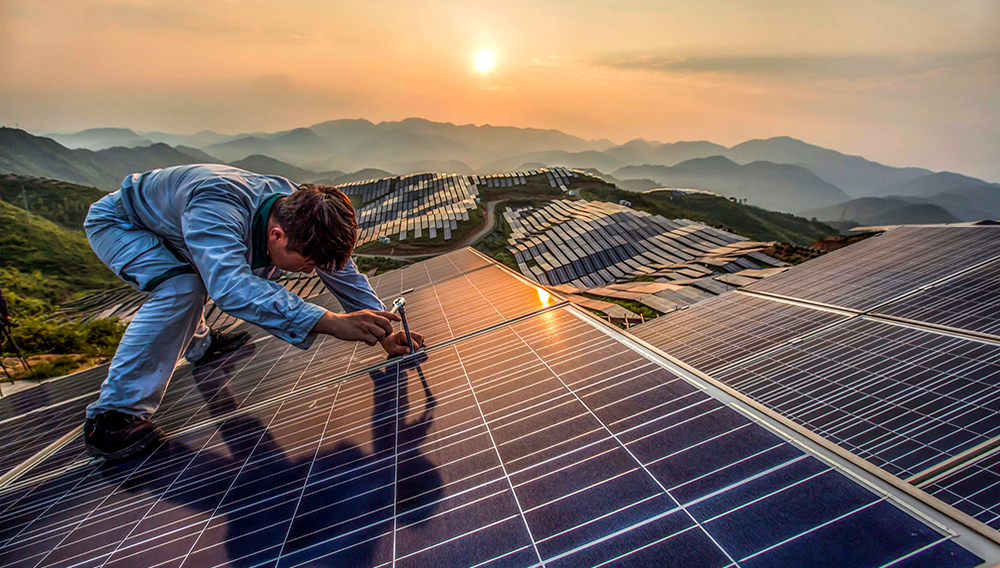A worker at Xinyi photovoltaic power station in Songxi, China. Photograph: Feature China/Barcroft Images