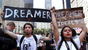 Jovan Rodrigo, 27, and Gloria Mendoza, 26, take part in a protest near Trump Tower on Sept. 5, 2017, in New York. Both said they were brought to the United States from Mexico when they were children.John Moore / Getty Images file