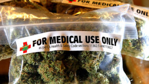 One-ounce bags of medicinal marijuana are displayed at the Berkeley Patients Group March 25, 2010 in Berkeley, California. (Photo by Justin Sullivan/Getty Images)