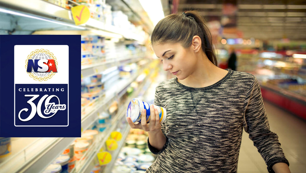 Young woman reading ingredients, declaration or expiration date on a dairy product before buying it.