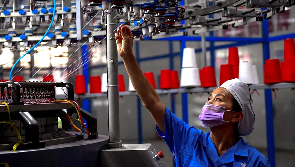 A growing number of Chinese companies are evading US President Donald Trump's tariffs by shifting production overseas to countries such as Vietnam. Photo: AFP