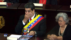 Nicolas Maduro covers his mouth and looks shocked. Photo: Boris Vergara/picture alliance via Getty Images