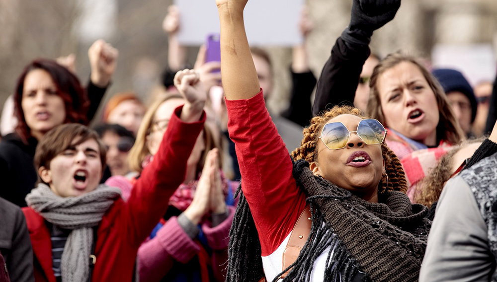 Demonstrators for women's rights listen to a speaker at the St. Louis Women's March on Jan. 20. | wsj.com