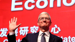 Apple CEO Tim Cook waves as he arrives for the Economic Summit held for the China Development Forum in Beijing on March 23, 2019. (AFP)