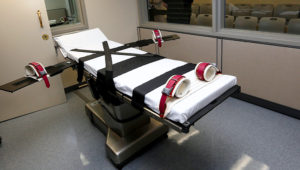 This Oct. 9, 2014, file photo shows the gurney in the the execution chamber at the Oklahoma State Penitentiary in McAlester, Okla. (AP Photo/Sue Ogrocki, File)