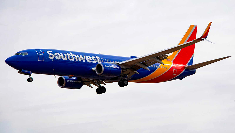 A Boeing 737 800 flown by Southwest Airlines approaches for landing at Baltimore Washington International Airport near Baltimore, Maryland on March 11, 2019. (Photo by Jim WATSON / AFP)