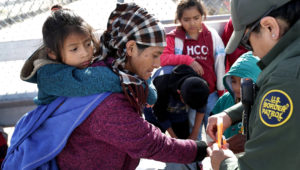 Central American migrants are taken into custody by U.S. Border Patrol agents in El Paso on Feb. 1. (John Moore/Getty Images)