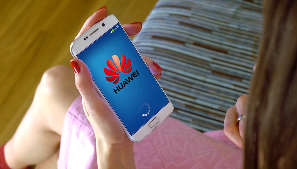 Young woman holding a cell phone with loading Huawei mobile app. Conceptual editorial 4K clip Stock Video Footage - Storyblocks Video