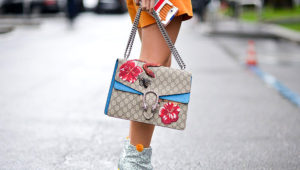MILAN, ITALY - FEBRUARY 29: Yuwei Zhangzou poses wearing Chiara Ferragni shoes and Gucci bag after the Giorgio Armani show during the Milan Fashion Week Fall/Winter 2016/17 on February 29, 2016 in Milan, Italy. (Photo by Vanni Bassetti/Getty Images)