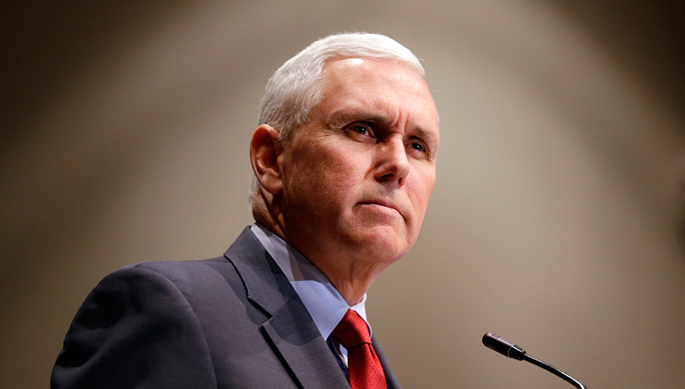 Indiana Gov. Mike Pence announces that the Centers for Medicaid and Medicare Services had approved the state's waiver request for the plan his administration calls HIP 2.0 during a speech in Indianapolis, Tuesday, Jan. 27, 2015. (AP Photo/Michael Conroy)