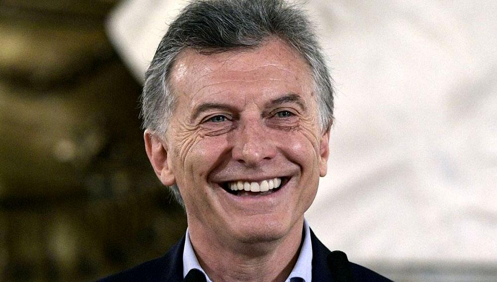 Mauricio Macri en primer plano de rostro sonriendo.