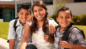 Cute Brothers and Sister Wearing Backpacks Ready for School.