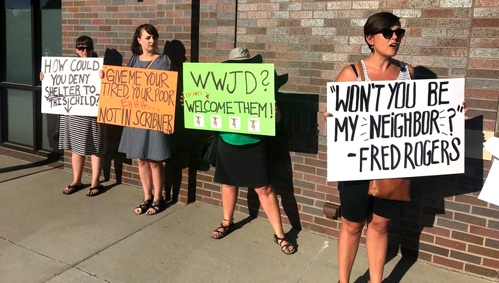 Protesters gather outside a meeting of the Scribner City Council to oppose an ordinance that would bar illegal immigrants from getting housing or jobs in town. Ultimately, the council decided to put the issue to the voters. PAUL HAMMEL/THE WORLD-HERALD