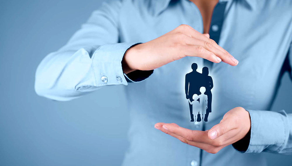 Family life insurance, family services and supporting families concepts. Businessman with protective gesture and silhouette representing young family. Photo stock.