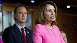 House Minority Leader Nancy Pelosi, D-Calif., joined by Rep. Adam Schiff, D-Calif., speaks July 17 during a news conference on President Donald Trump's meeting with Russian President Vladimir Putin in Helsinki. (Jose Luis Magana / AP)