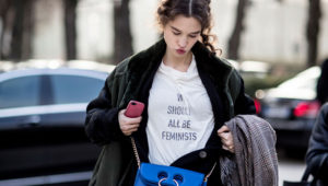 Accessorize with an eye-catching shoulder bag that'll (subtly) highlight your message. Image: Imaxtree